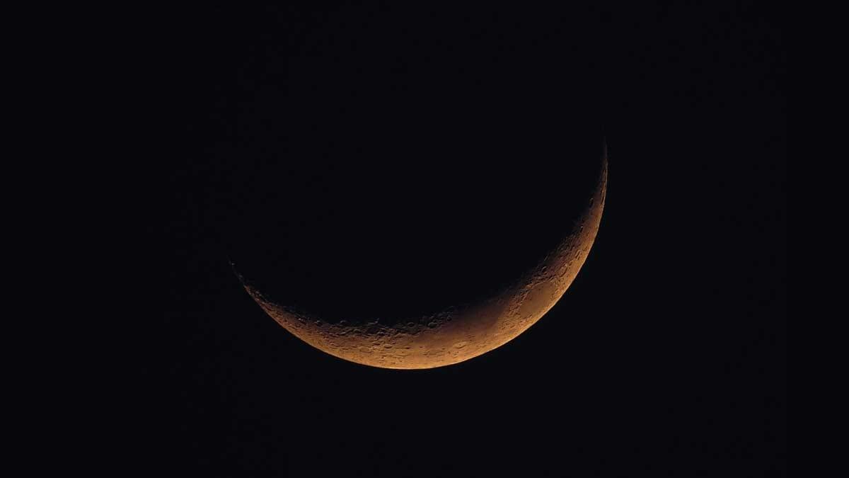 New Moon with orange glow