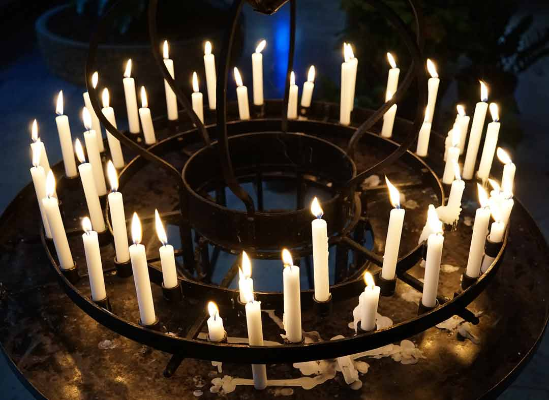 circle of candles lit in the darkness
