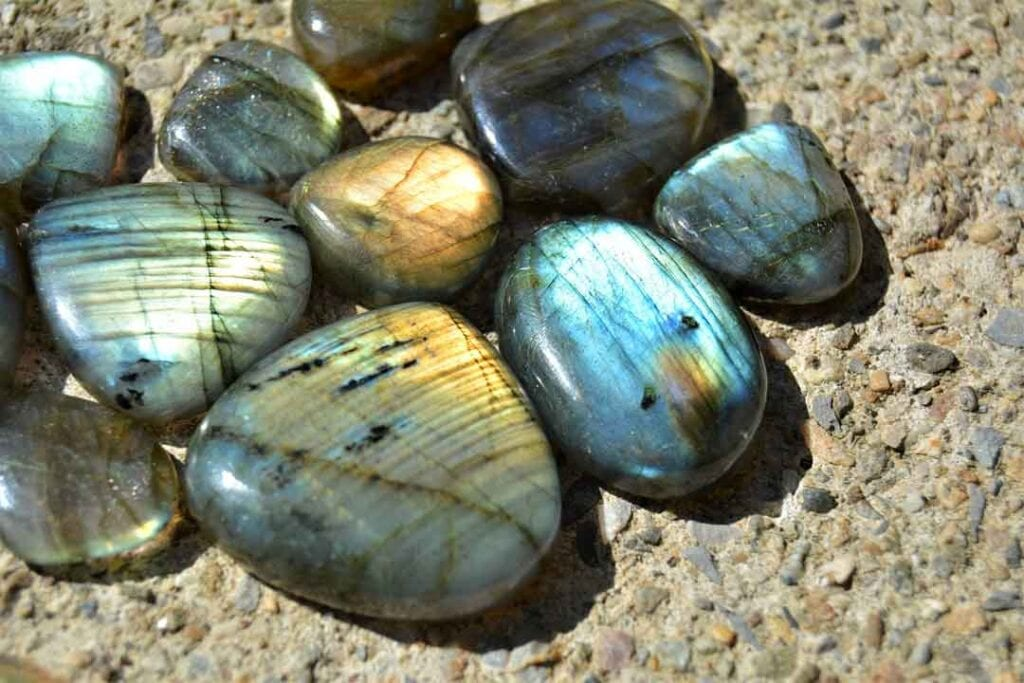 an array of polished Labradorite stones in the sun