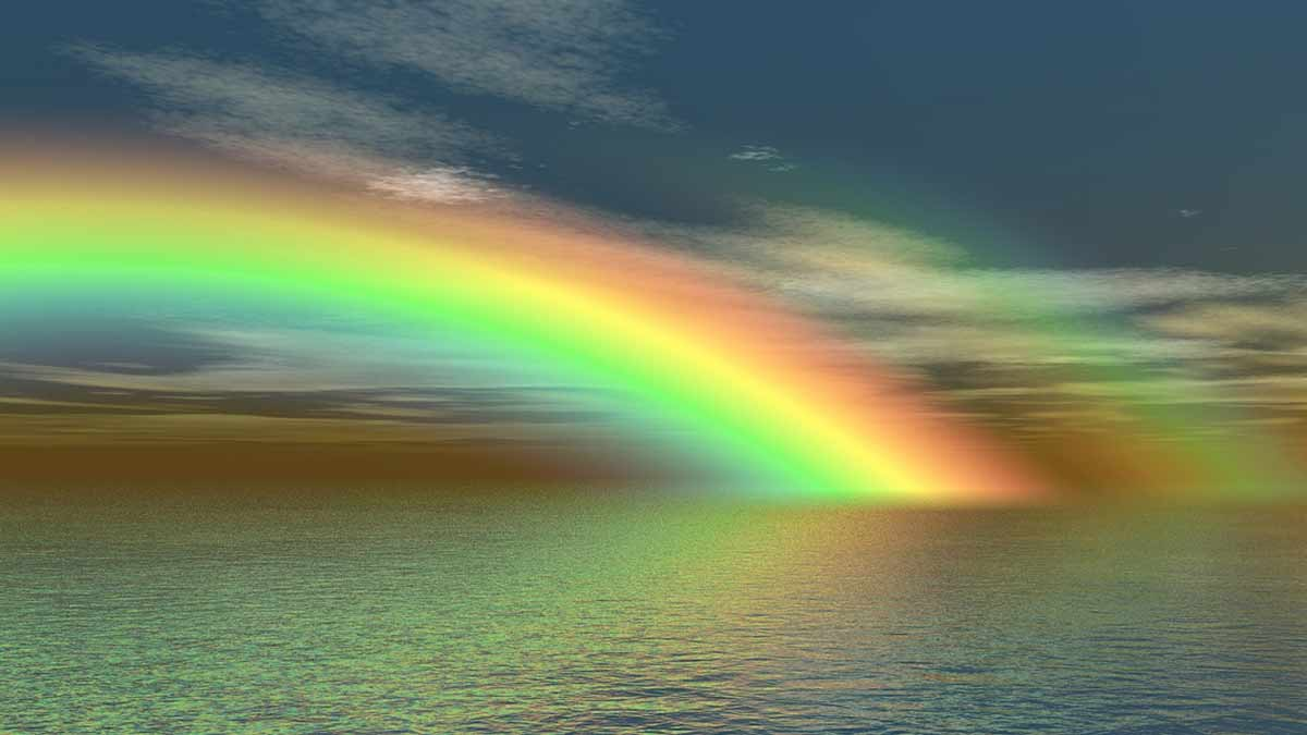 Chicago Reiki - brilliant rainbow over a body of water