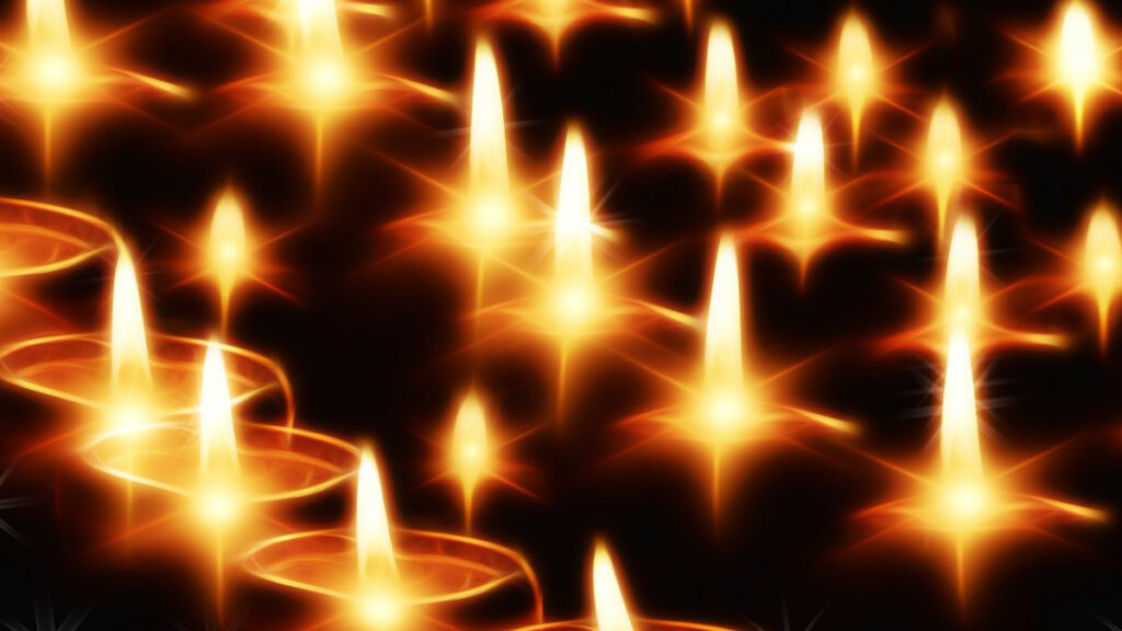 Chicago Reiki - Holy Fire® - Image of several candles burning in the darkness