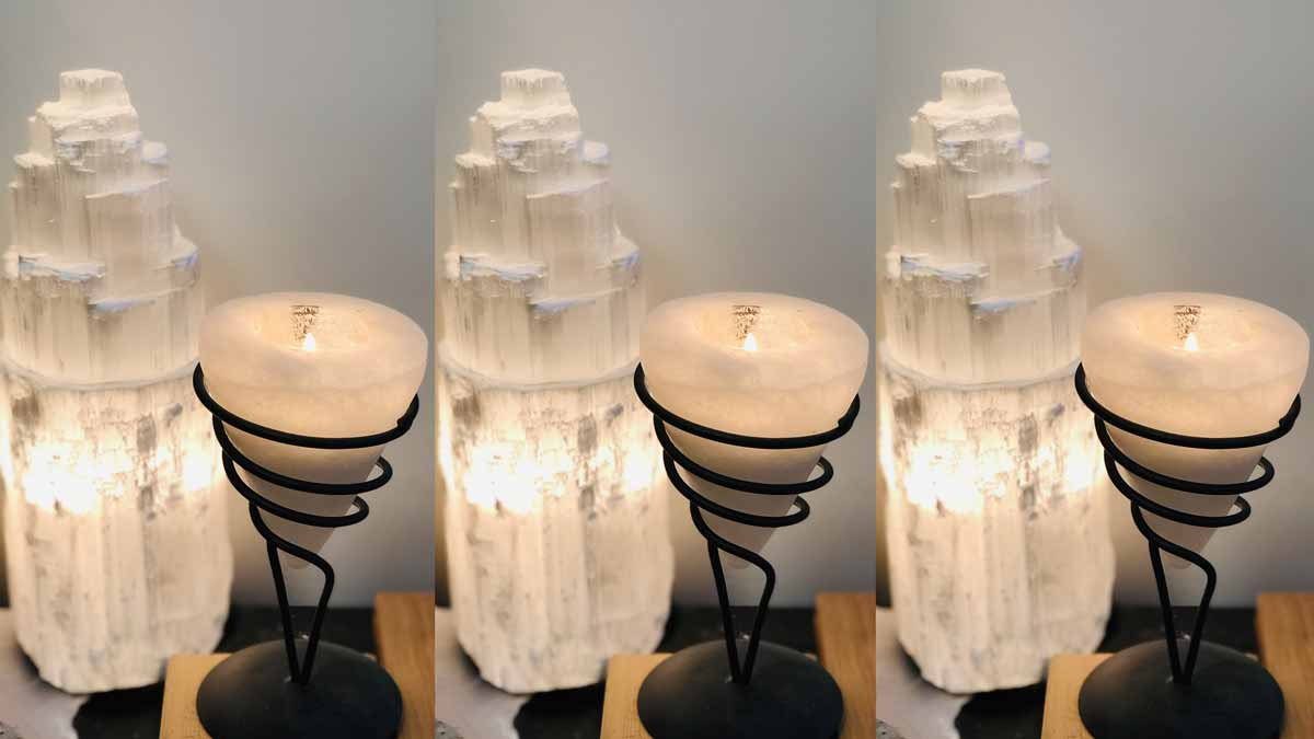 Jerry Mikutis Chicago Reiki and Crystals - Selenite - selenite tower next to a cone shaped selenite candle