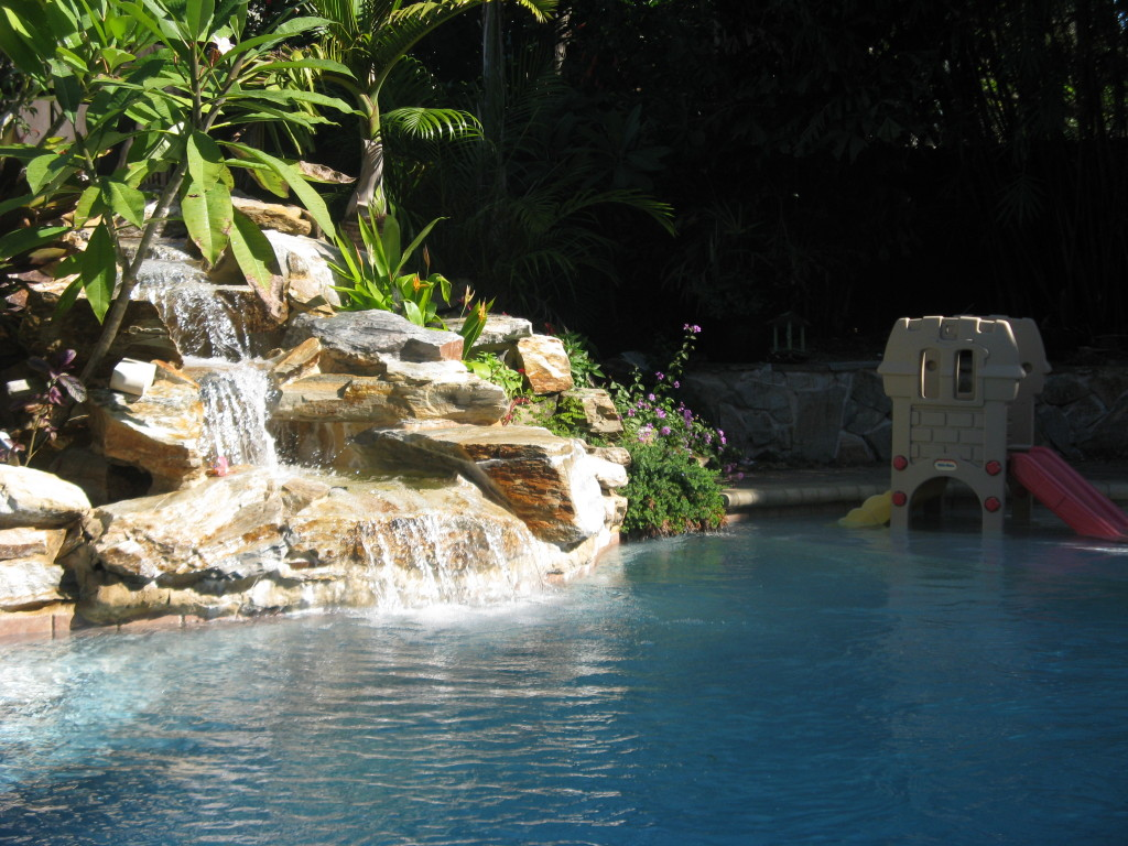 real rock waterfall for new swimming pool, west palm beach