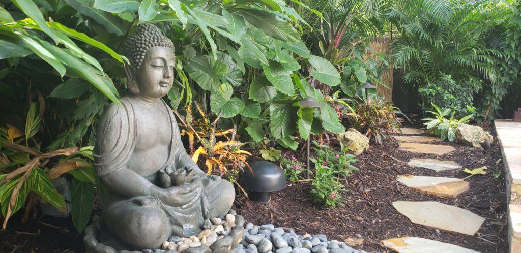 Buddha statuary in garden by walk path, west palm beach