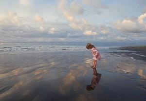 girl on beach exploring