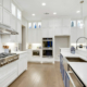 White kitchen cabinets with blue accents