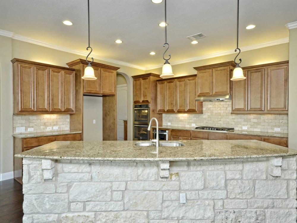 Kitchen cabinets light stain stone island