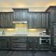 Mitered raised panel kitchen cabinets in dark stain