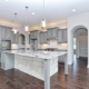 Gray kitchen cabinets with stone island