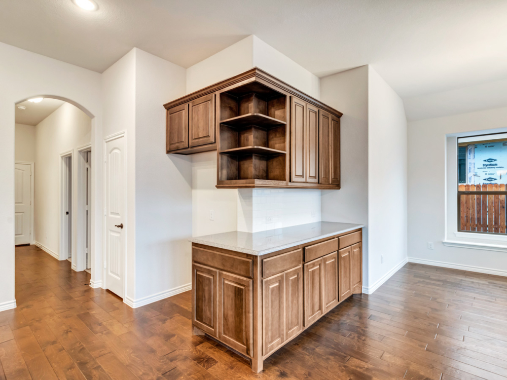 Cabinet Specialists corner cabinet with open shelves stained