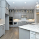 gray kitchen cabinets with glass uppers