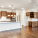 Cabinet Specialists' medium stained wood kitchen