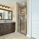 Master bath with mitered doors in medium stain