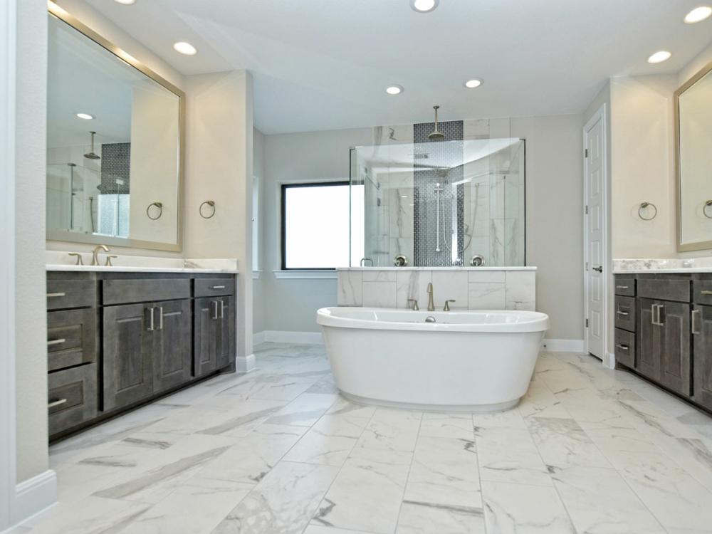 Master bath gray stain center tub