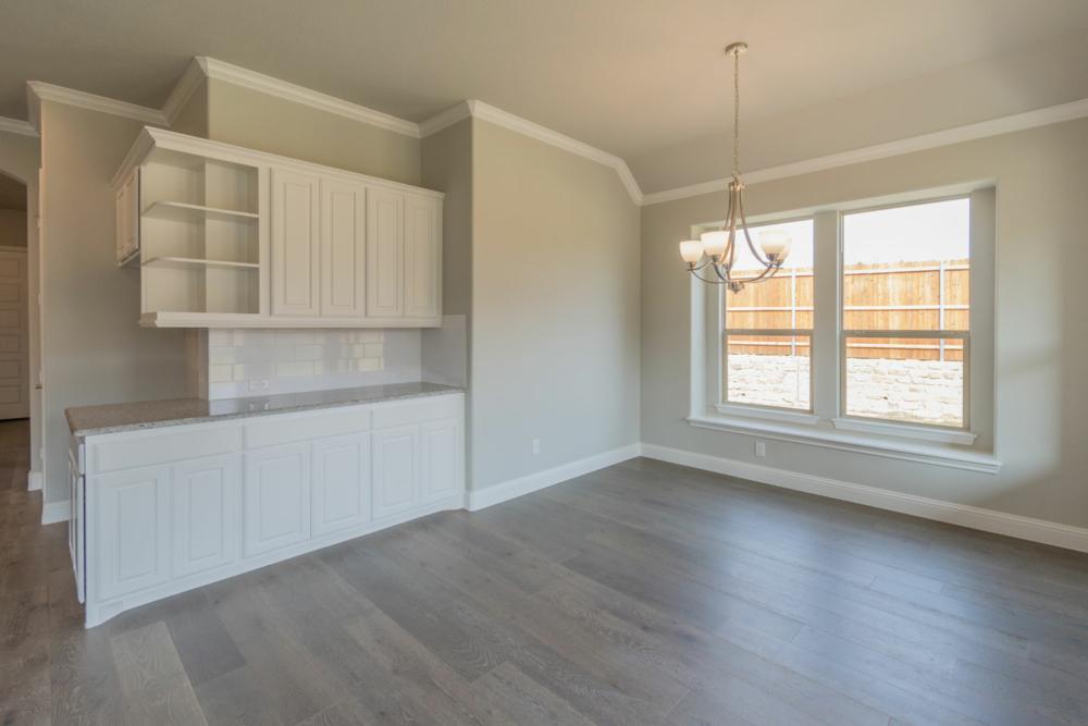White kitchen corner cabinets open bookshelves