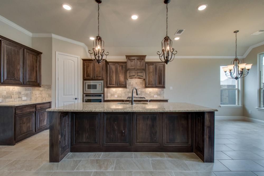 Kitchen with wood wainscot island