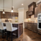Kitchen with medium dark stain and wood vent hood