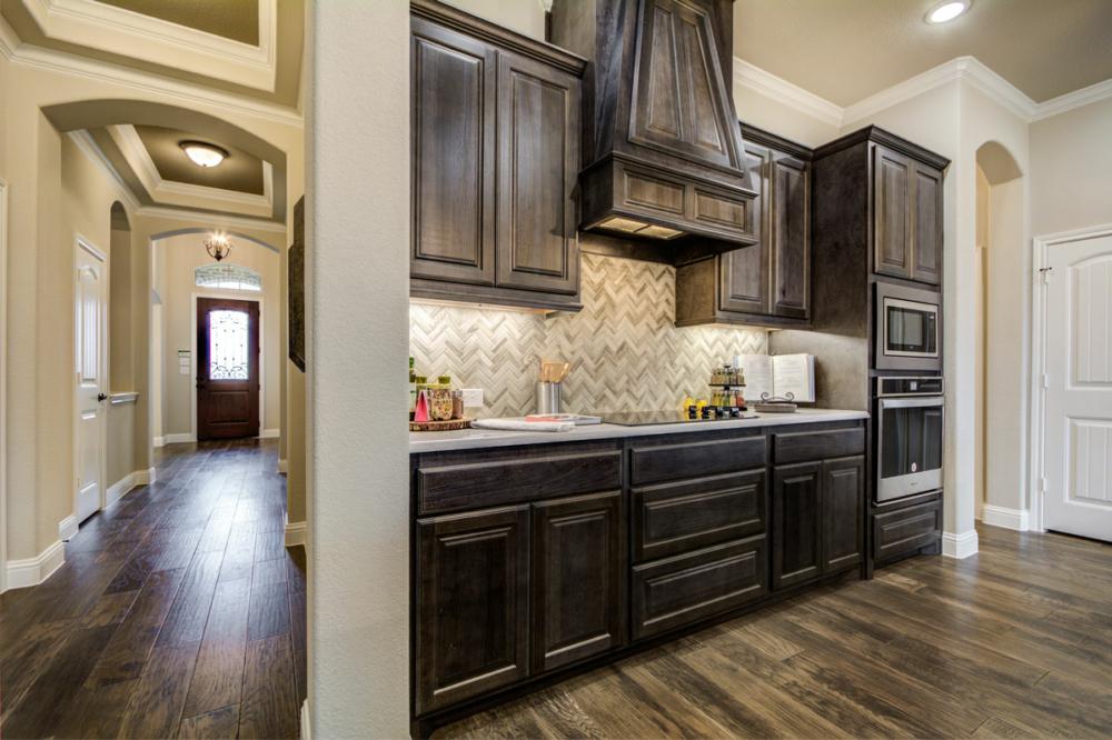 kitchen with angled wood hood