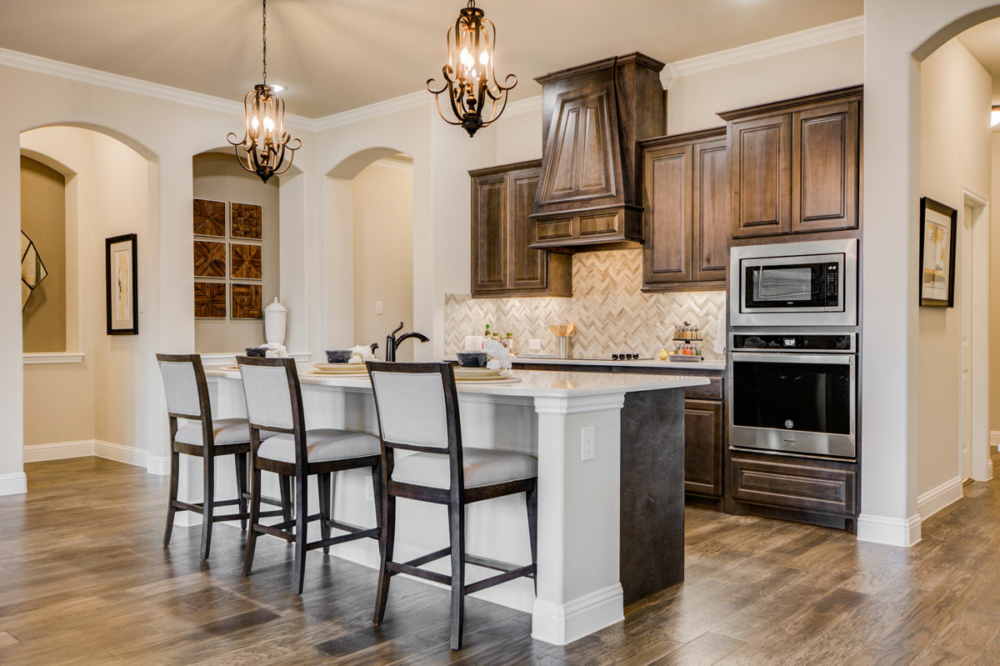 cabinets with angled wood vent hood