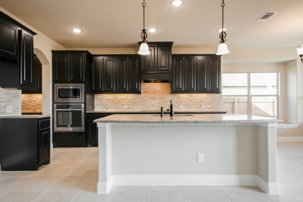 Kitchen cabinets with wood vent and black stain