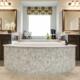 Master bath tub separated vanities