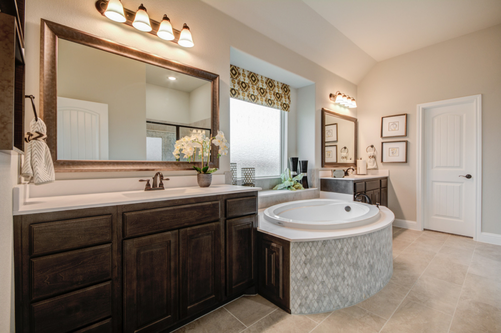 Master bath cabinets with tiled center tub