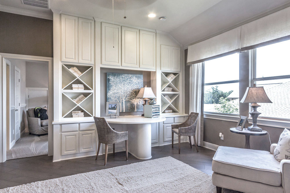Built-in desk with white cabinets and Big X storage
