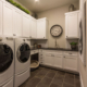 Laundry room with extra cabinets and storage