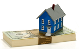 Miniature House on Top of Cash - Home Equity Concept