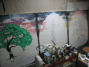 """Digital photo of an early in-progress shot of 3 acrylic paintings comprising the """"3 Trees Triptych"""": respectively entitled """"Rebellion: The Tree of Knowledge of Good and Evil"""", """"Redemption: The Tree of the Cross"""" and """"Reunion: The Tree of Life"""", all are © 2017 (Linda) """"Eilee"""" S. George, 48""""w x 60""""h each, part of the Israel Series for Calvary Community Baptist Church in Northglenn, CO; lovingly painted with squarish strokes in a Neo-Pixelist style in many colors; each signed L. Eilee George with logo"""