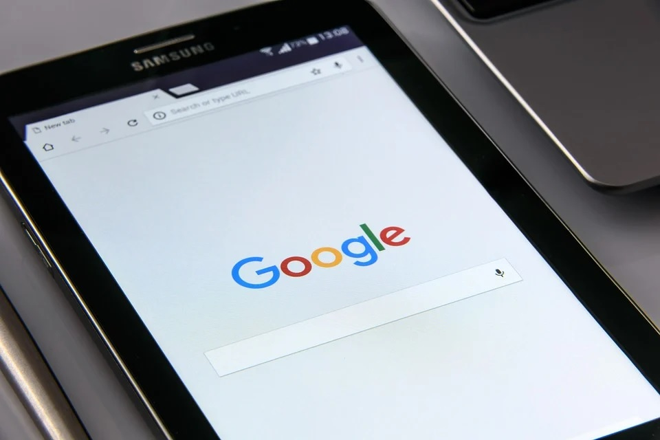 A black Samsung smartphone that displays Google's search engine page.