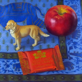 Oil painting by Joanna Strong of a toy Labrador retreiver, an apple and a packet of maple candy, on Indian fabric showing an elephant.