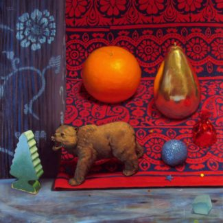 Oil painting by Joanna Strong of miniature bear, orange, tree and golden pear, and Indian fabric.