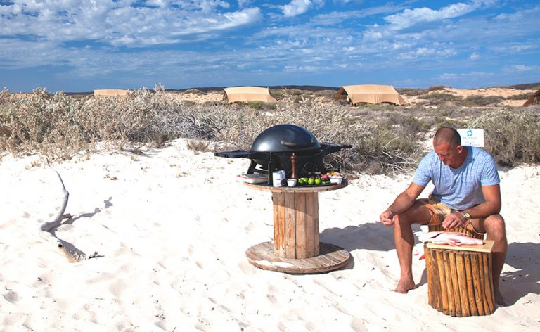 Ed cooking on the beach