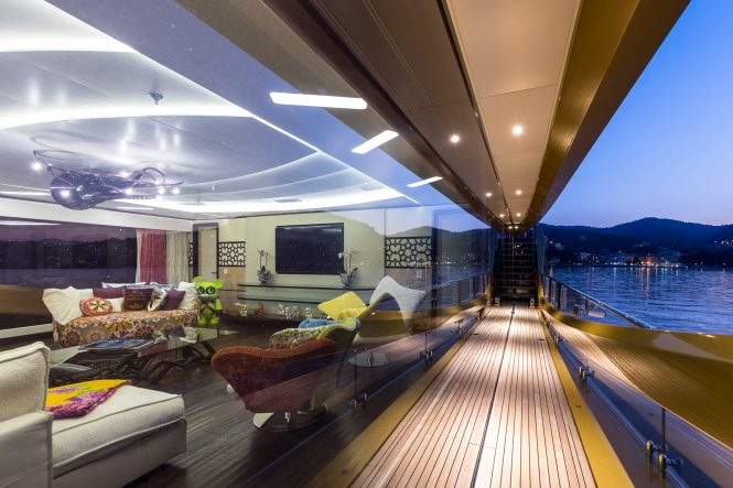 Discounted weekly rate in the West Med with striking 49m superyacht KHALILAH side deck looking inside the saloon 665x443 1 BB Yacht Charter Marbella
