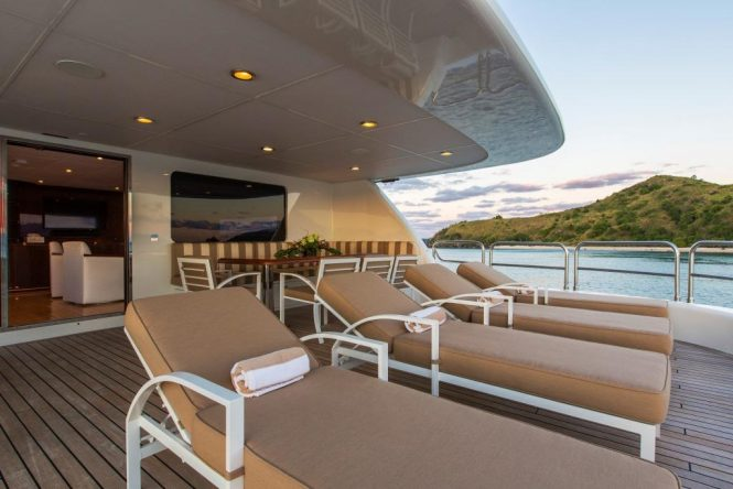 Aft deck with alfresco dining area and sunbathing area