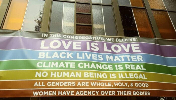 Love is love banner on front of UUCTC