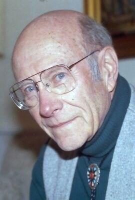 Photo of John Wilms, looking at camera