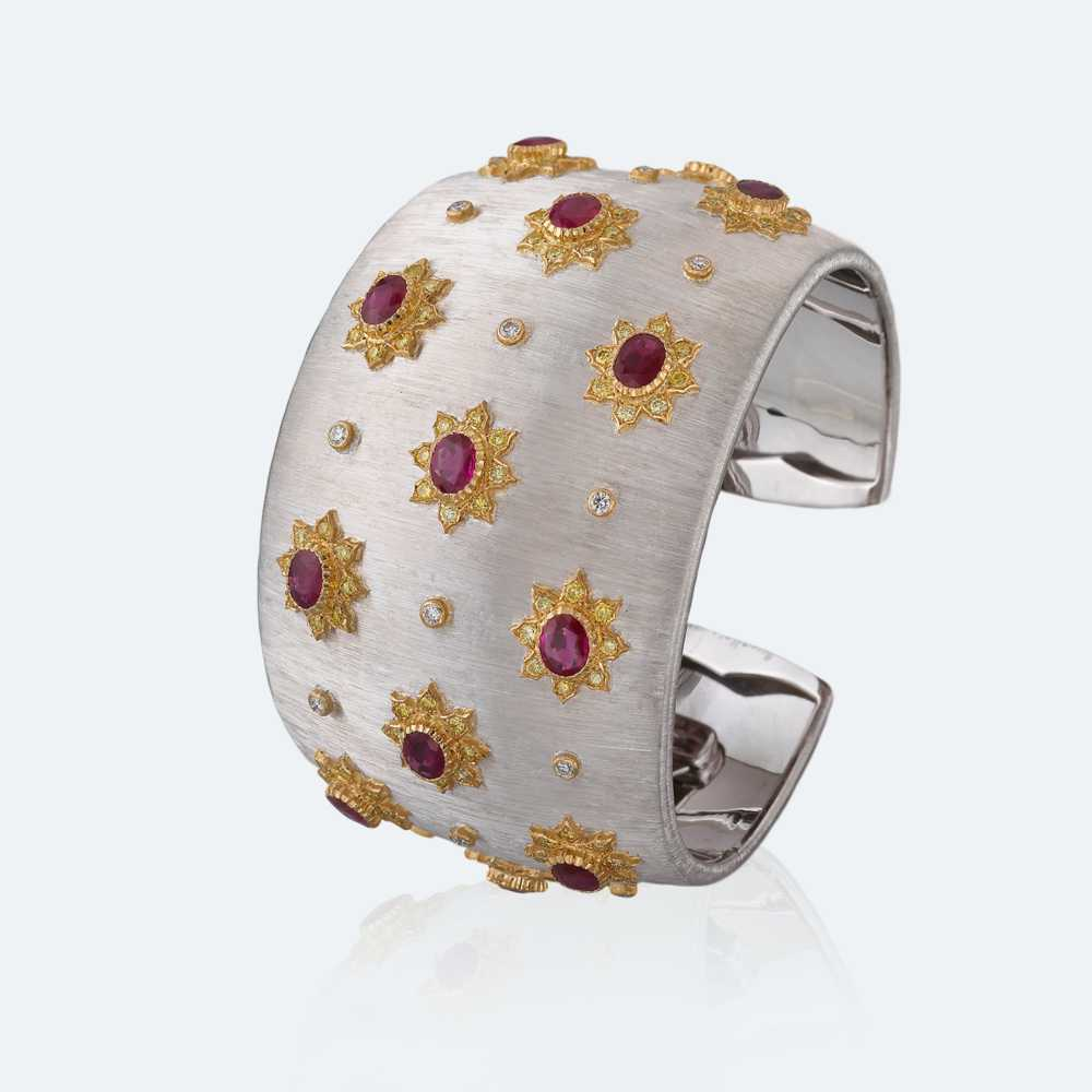 White and yellow gold with rubies, diamonds and fancy yellow diamonds