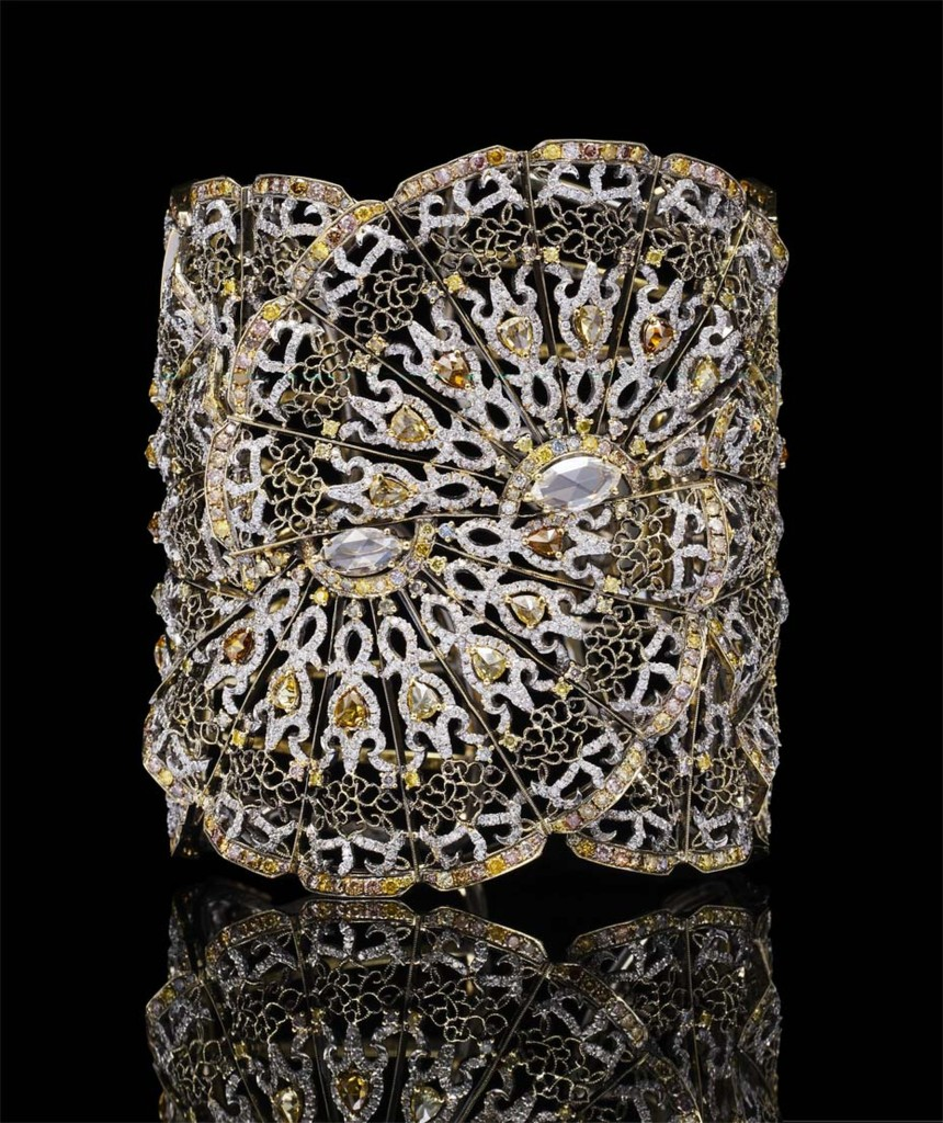 Bao Bao Wan Fan bangle in yellow gold, set with yellow, cognac and pink diamonds, white diamonds and two marquise-shaped diamonds
