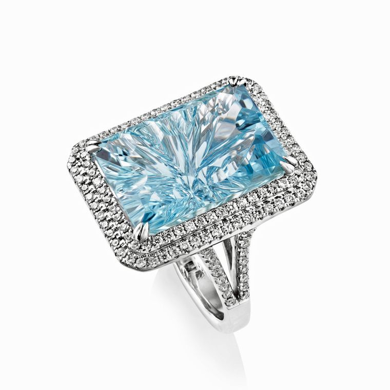 White gold ring by Sheldon Bloomfield set with a carved aquamarine and diamonds