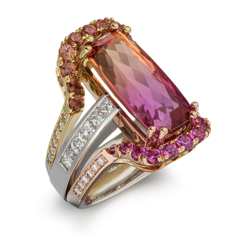 One-of-a-kind 10.65 ct Bi-Color Precious Topaz embellished with Natural Umba Sapphire, Pink Sapphire, and Diamond. Set in 18k Rose, 18k Yellow, and Platinum.