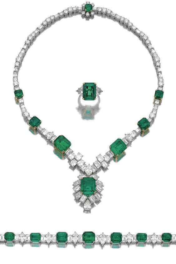IMPORTANT EMERALD AND DIAMOND PARURE. Comprising: a necklace, a bracelet and a ring, set with square and rectangular step-cut emeralds, marquise- and pear-shaped, brilliant- and step-cut diamonds.