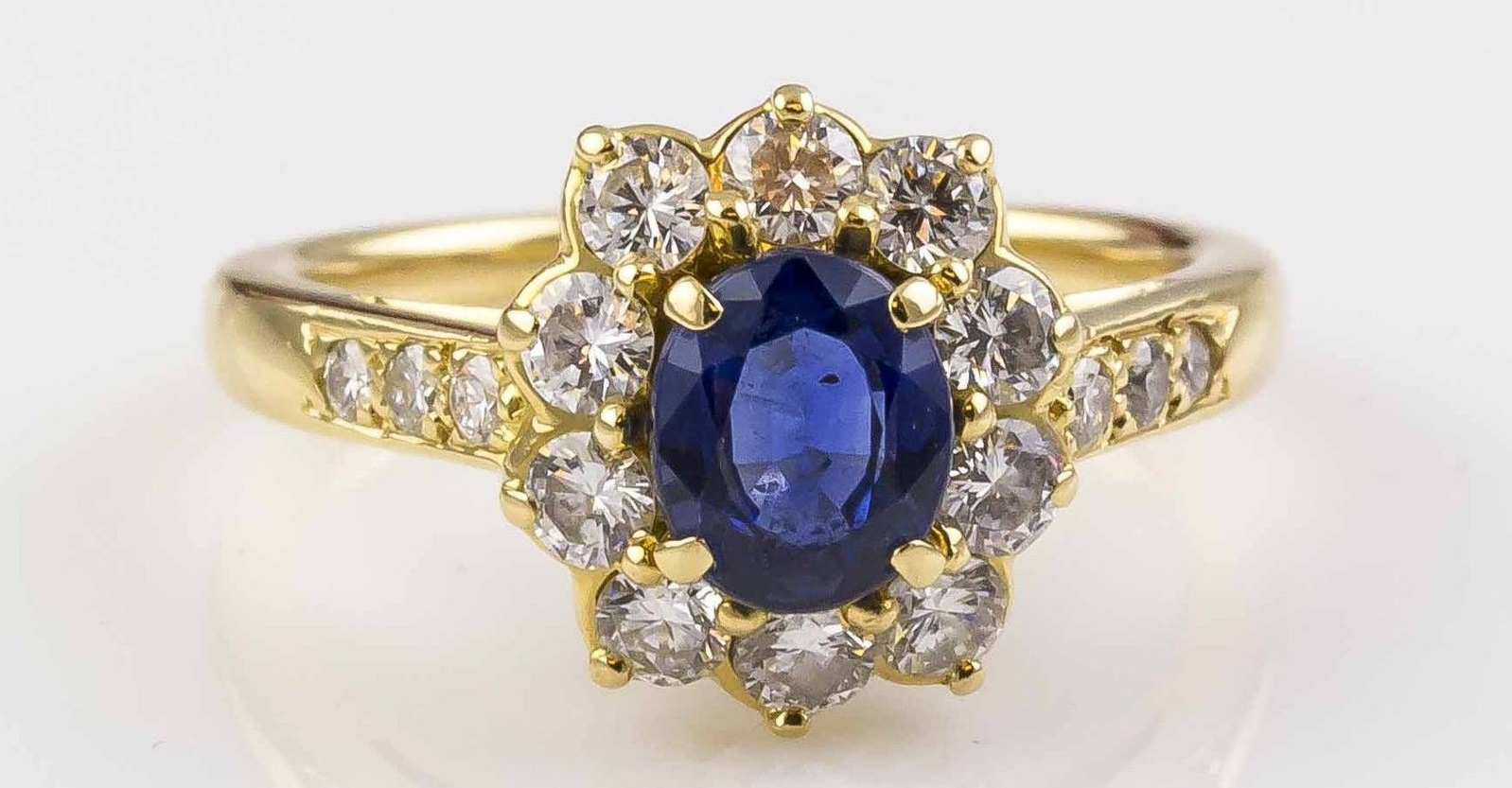 Charming and elegant 18K yellow gold, sapphire and diamond cocktail ring by Cartier.