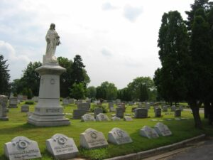 Colonial Memorial park cemetery with prominent memorial statue in foreground