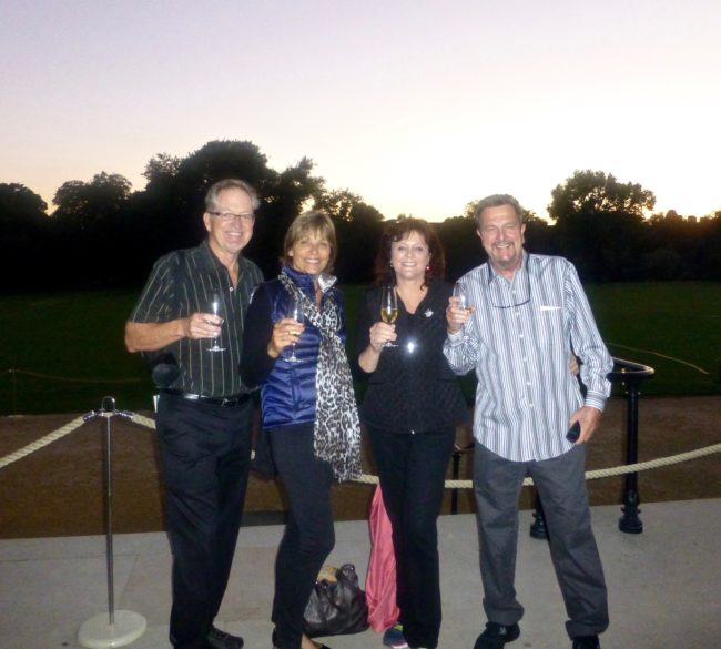 Tom and Tracy with friends toasting