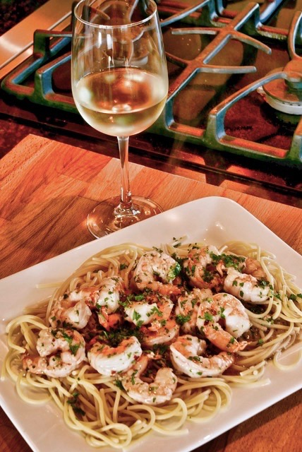 white wine and shrimp scampi in garlic butter sauce