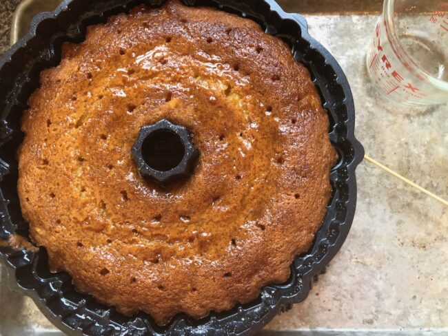 citrus olive oil bundt cake with drizzled syrup on top