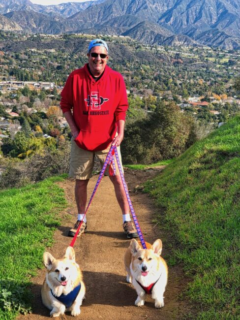 Tom with two Corgis on a Leash