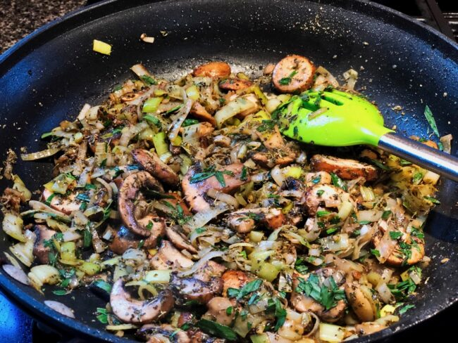garlic, leeks, and mushrooms in a skillet